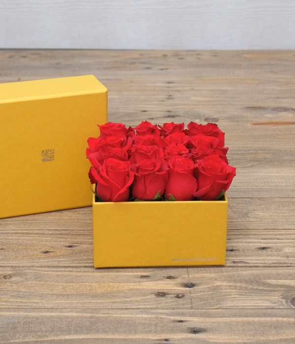 Red Canary: A Flower Centerpiece in a Box